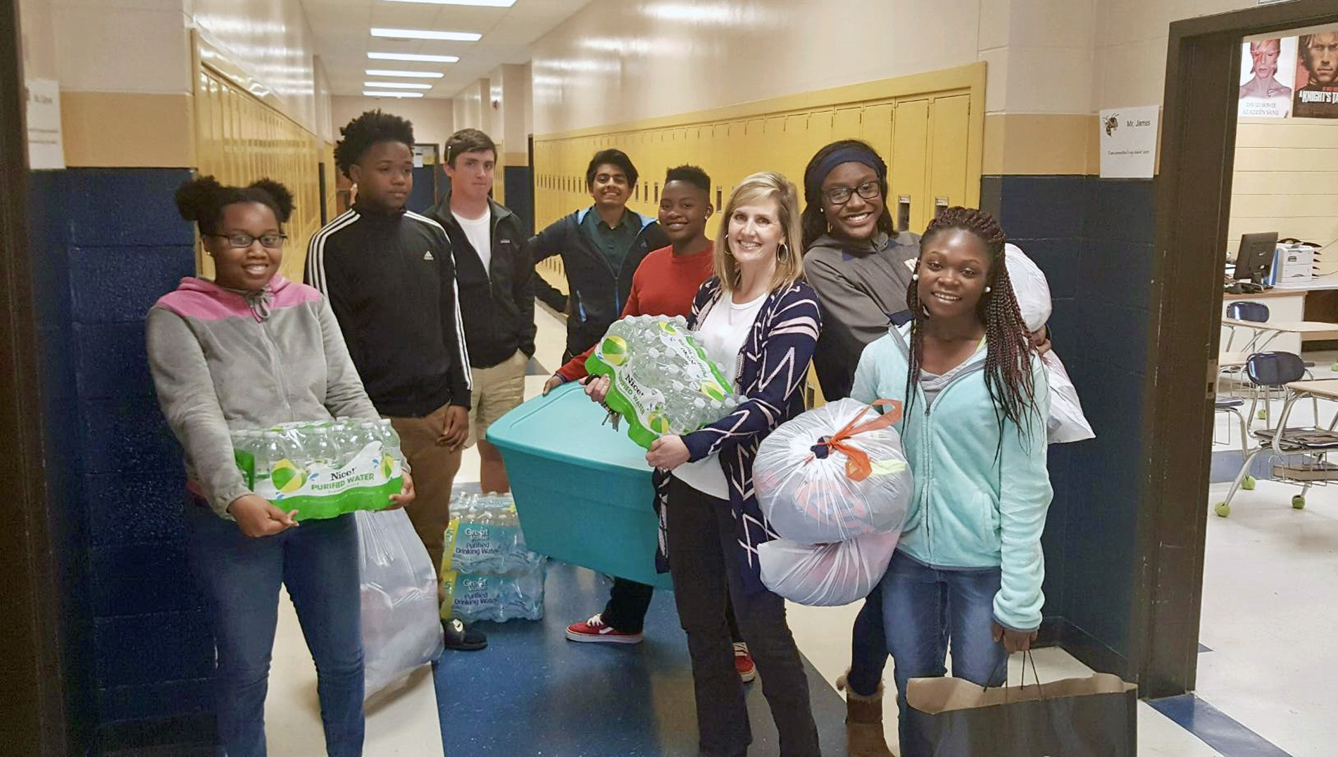 TCCHS students Charadi Paytee, Dondre Daniels, Blake Kirkendoll, Sanny Patel, Arina Warren, Leigh Barwick (teacher), Ilyria Johns, and Eurica Bush pause for the camera with some of the donated items.