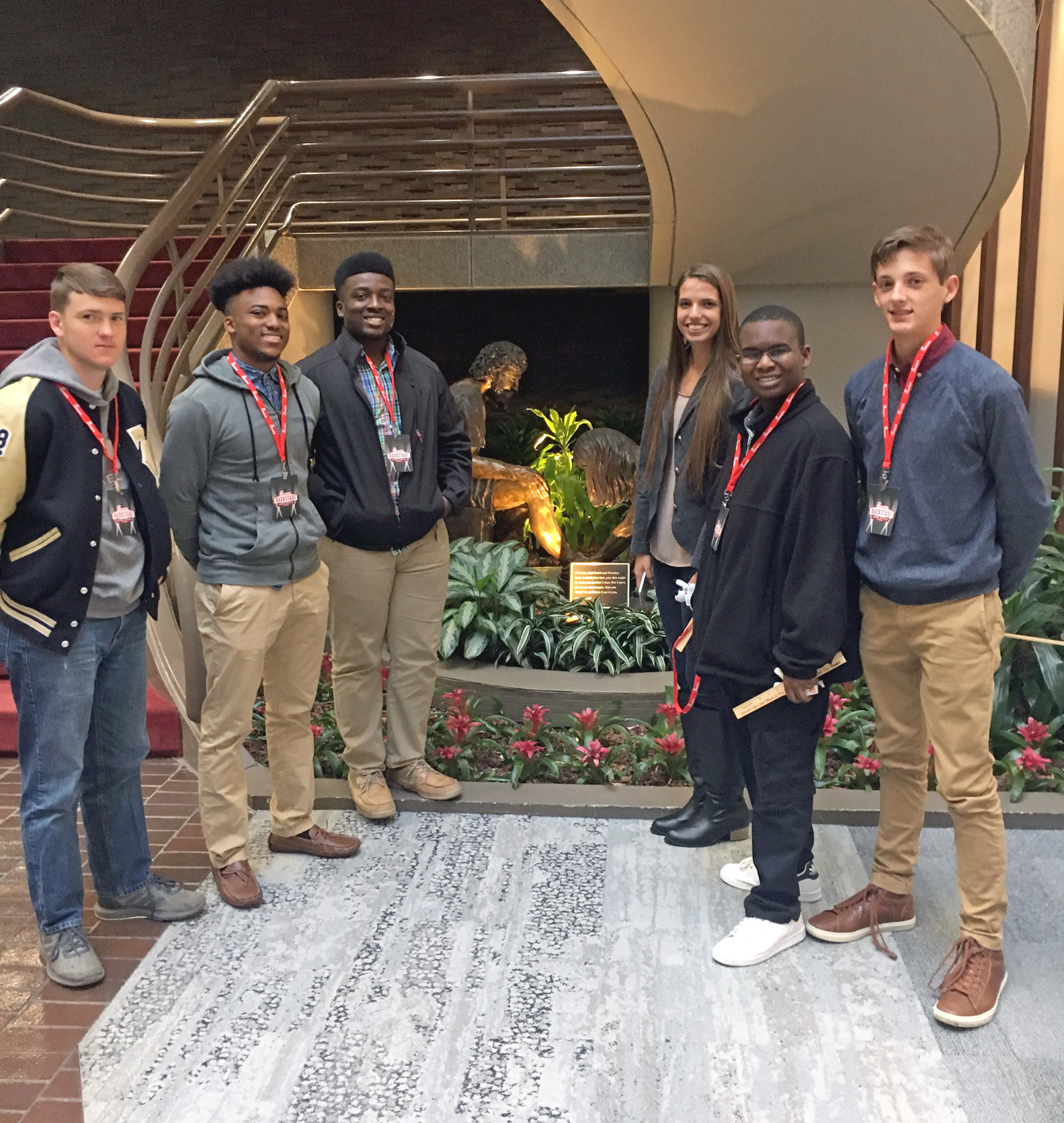 TCCHS student leaders (left to right) Jonathan Mills, Carlie Dismuke, Robert Scott, Kennedy Ward, Cameron Hadley and Zach Goff stop in the atrium of Chick-fil-A corporate headquarters.
