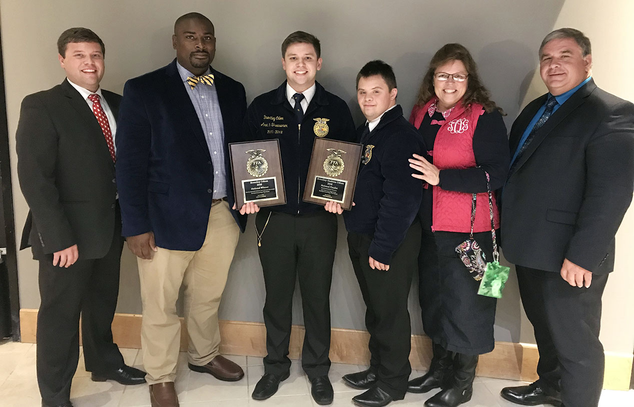 The Odom family and TCCHS FFA Advisor Glen Gosier celebrate Brentley Odom's win at the 91st National FFA Convention & Expo in Indianapolis, Indiana.