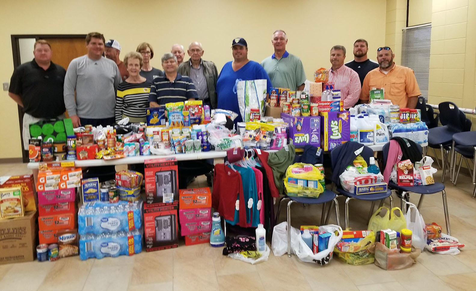 Members of TCCHS Athletic Boosters pose with Hurricane Michael donations.