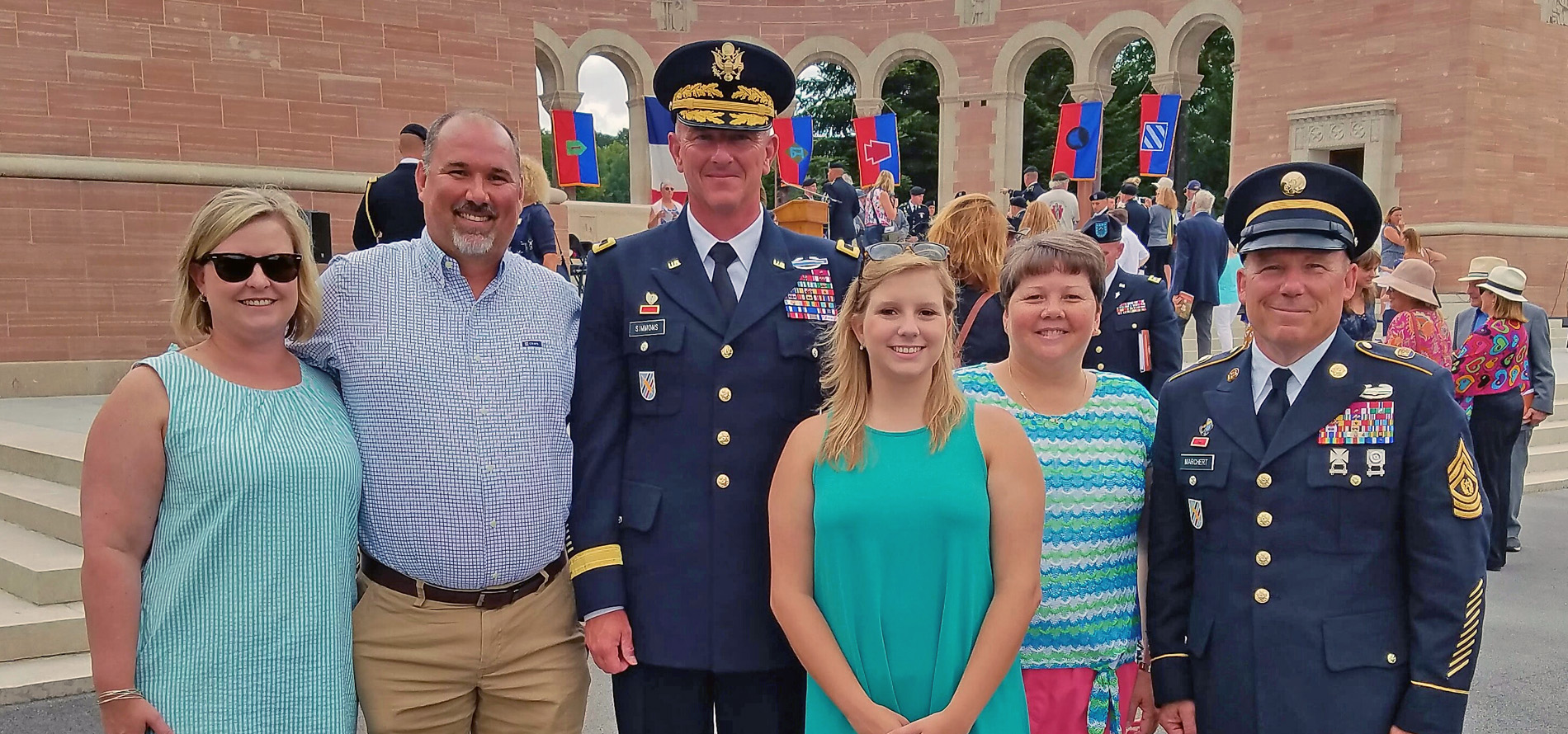 Brooklyn Reese, her family, teacher, and Georgia National Guard members share a photo opportunity during the WWI Centennial Commemoration ceremony.
