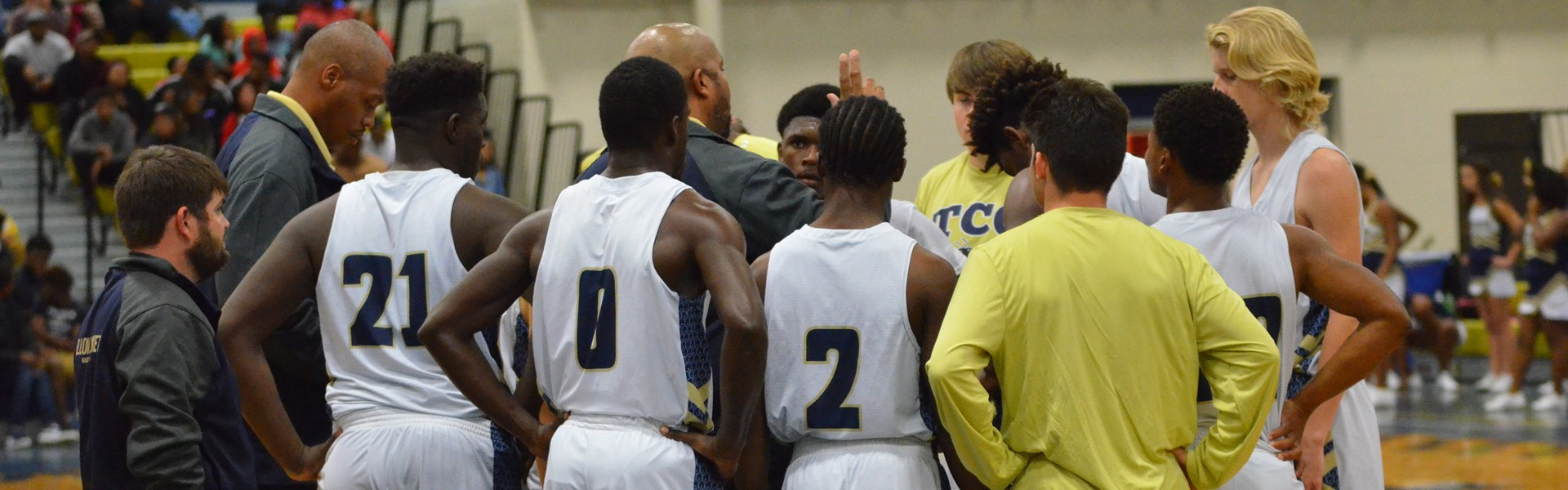 TCCHS boys basketball coach, Wil Lewis, speaks with his team during a time out at a recent game.