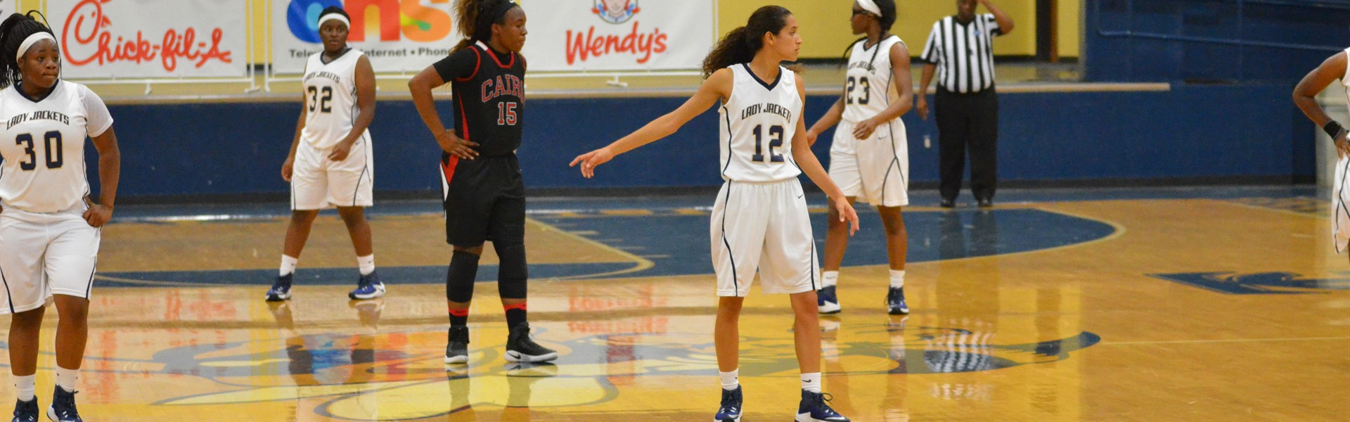 Senior Jade Guyton directs her teammates ae they prepare to play defense against Cairo in a recent game.
