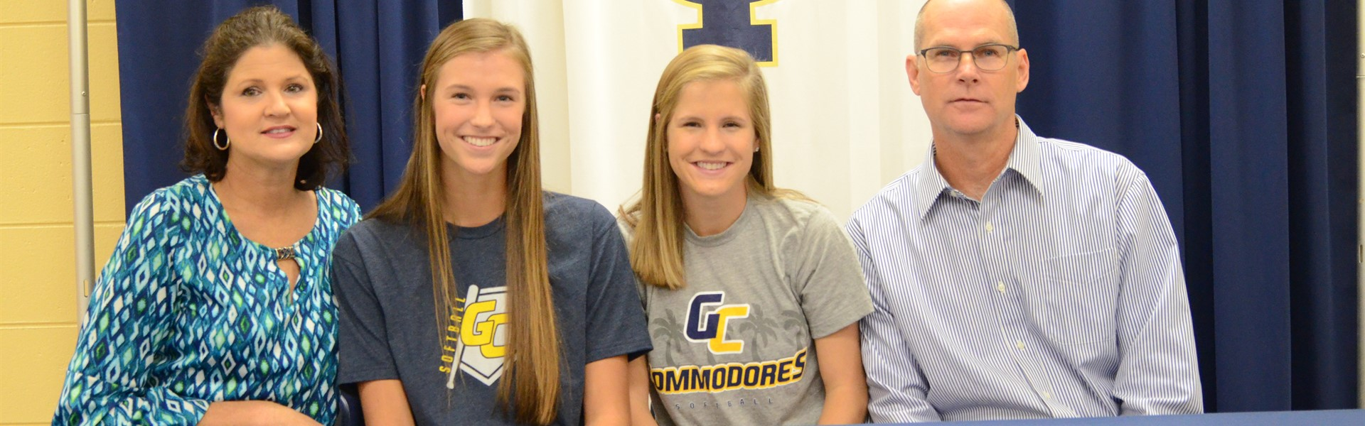 Anna and Emily Greek sign to play softball at Gulf Coast Community College.