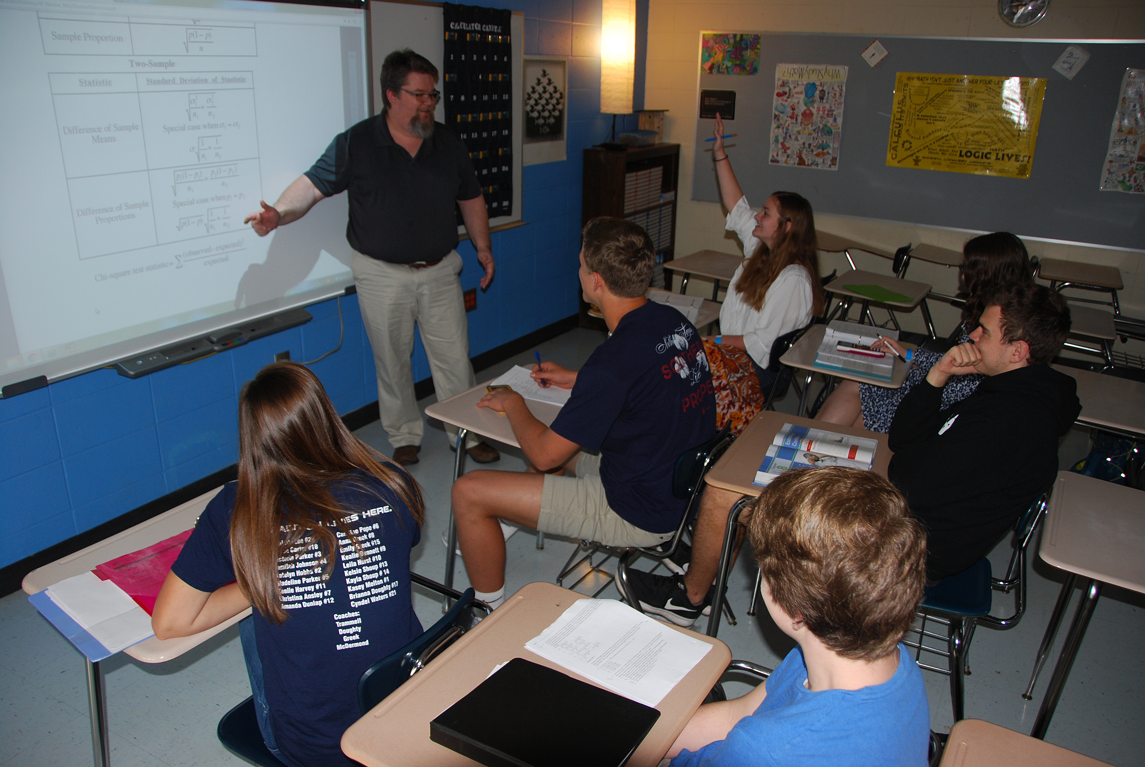 Thomas County Central High School math teacher Darrin Minns instructs his AP Statistics class how to use the Statistics Formula Sheet on an exam.